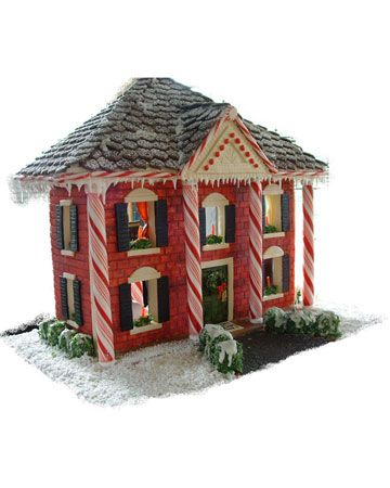 Wow! What a gingerbread house! Love the roof and the peppermint stick columns. Gorgeous!