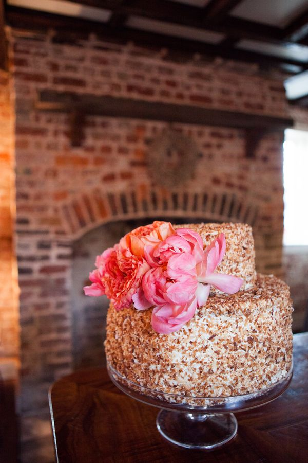Toasted chopped nuts cover the cake for this tropical wedding.