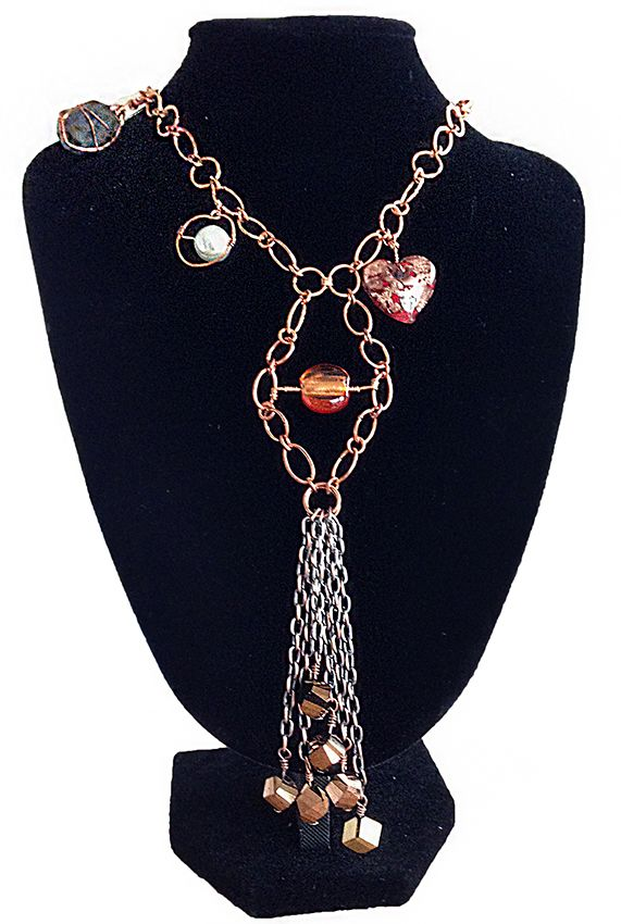 Long copper chain with various pendants - heart, crystal, beads.