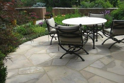 How much does flagstone cost? Only $15-20 per square foot (national average). This price includes the base material (either concrete or compacted sand and gravel) and mortar, and labor costs. Get more info on the pricing of flagstone here: http://www.landscapingnetwork.com/flagstone/cost.html Landscape shown designed by Accent Landscapes in Colorado Springs, CO.