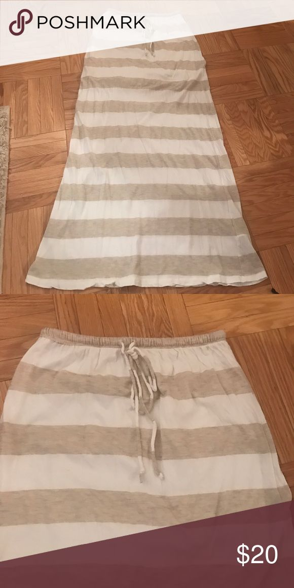 Stripped Maxi Skirt Cream and white stripped high waisted maxi skirt in size small. There is a Skirt sewn on the inside so it is not see through at all Skirts Maxi