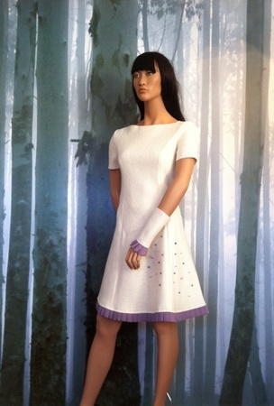 "MinSin, natural colored wool dress with short sleeves and wrist warmers.  ""tULL"""