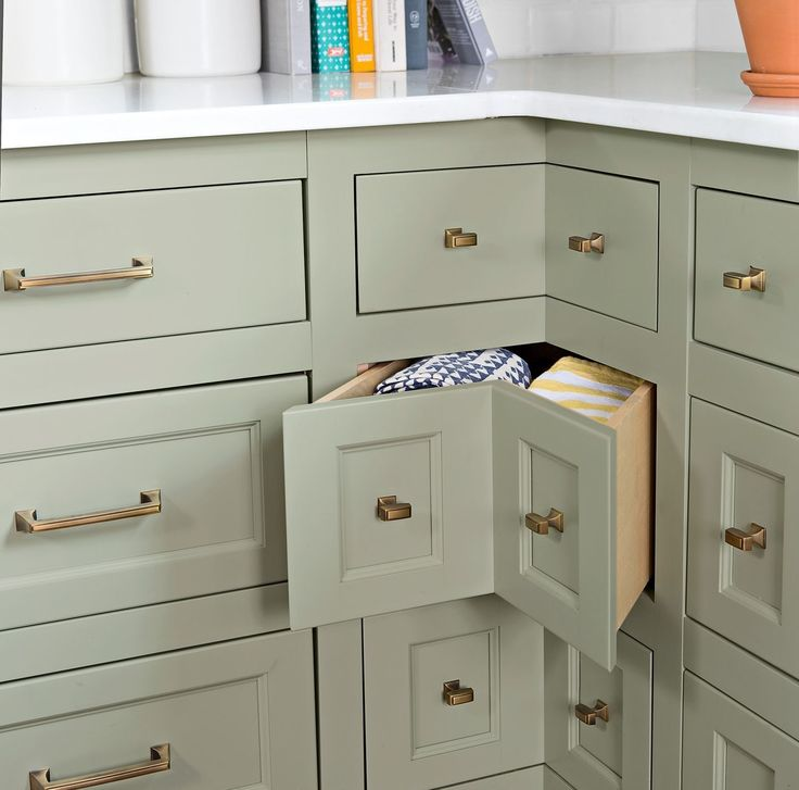 Corner drawers utilize every inch of interior cabinet space, topped by polished white-marble counters for a clean, bright look.