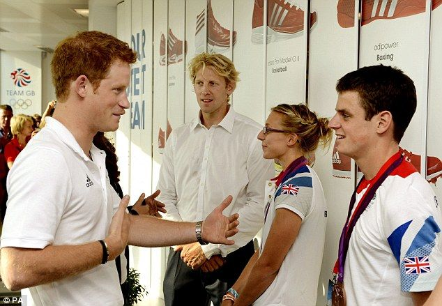 Down to earth: Prince Harry talks to Bronze medal winning triathlete Jonathan Brownlee who described the Royal as very 'humble'