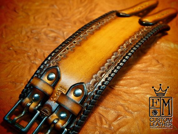 This 2.25 wide cuff is custom dyed in a light brown fade to black edges . Its stamped inside the perimeter and the edges are whipstitched in black leather lace. Two distressed roller buckles provide the closure!!! A great width for any wrist! Custom sized for your wrist!!!    I'll need your wrist size for this cuff! Please use the instructions in the pics above!    Thanks for checking out my work! I use a fine hand in my work bridging the gap between craft and art and truly love making You…