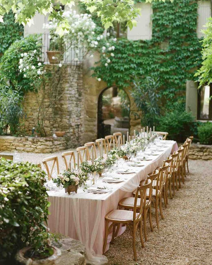 The reception took place in the inner courtyard of Petit Hopital, where tables lined with blush linens by La Tavola Fine Linen ---An Elegant Garden Wedding in Southern France | Martha Stewart Weddings