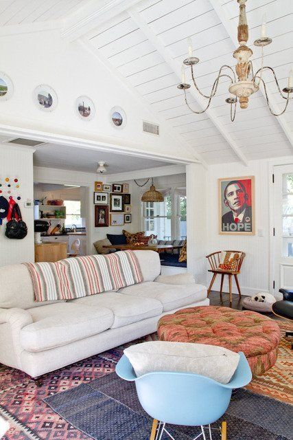 I like the colors & textures here but check out the photo collage on the back wall!