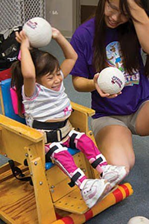 Once a month, coaches of Amazing Athletes of Eastern Oklahoma give their time to work with children at The Little Light House, a development center for children with special needs.