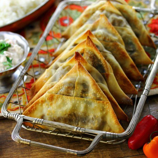 Spicy Vegetarian Lentil Samosas - an Indian street food classic made oven-crisp. With easy step-by-step samosa wrapping guide! Instead of egg wrap use a durum wheat  wrap or a rice wrap  ! Simple or even filo pastry ! Simple ! X