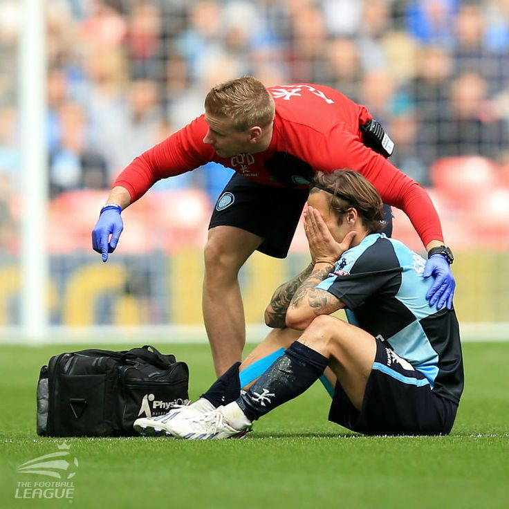 Wycombe Wanderers' Sam Saunders receives medical attention before leaving the pitch injured after just two minutes