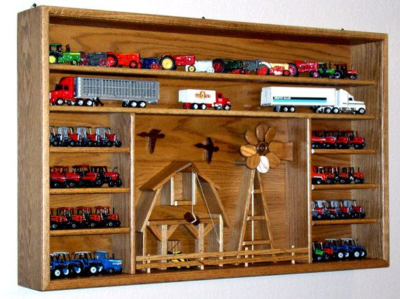 I think we know someone that can build something like this!  Farm Scene farm toy oak display case to proudly by OakCollection