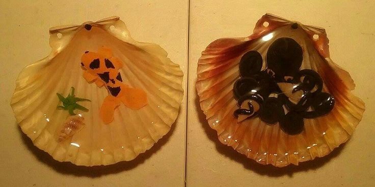Polymer clay fish and octopus set in resin in some scallop shells.