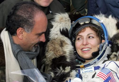 """Arkalyk, KAZAKHSTAN: The world's first female space tourist Anousheh Ansari (R) looks at her husband Hamid, after the landing of the Russian """"Soyuz TMA-8"""" space capsule not far from Kazakh town of Arkalyk (some 300 kms from Kazakh capital of Astana), 29 September 2006. The capsule carrying Iranian-born American national Anousheh Ansari, Pavel Vinogradov of Russia and US astronaut Jeffrey Williams touched down softly at 0114 GMT near Arkalyk, Russian news agencies quoted the Russian space…"""