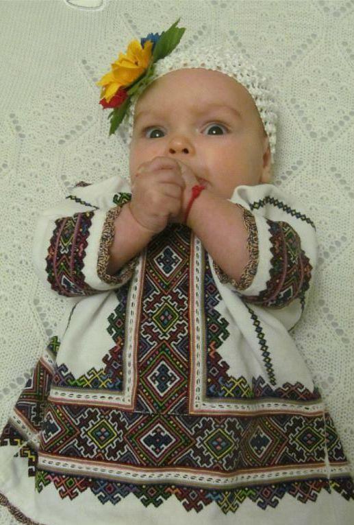 Колисала мати колиску кленову –  Виспівала доні долю веселкову…  А коли дитина міцно засинала, –  З молитвами щастя доні вишивала.  На Бога! На Сонце! На День Золотий!  На ніжність! На усміх! На погляд ясний!  На Долю щасливу, квітуче Життя –  Мережила мати доньці вишиття., Ukraine, from Iryna