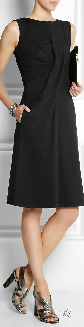 Black dress by Jil Sander. A knotted dress with an A-Line skirt. Feminine but a little boyish at the same time