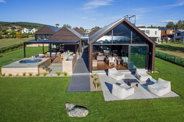 1. This lake house by Warren and Mahoney Architects is in Bremner Bay overlooking Lake Wanaka. It comprises a collection of five linked pavilions that create a series of courtyards for outdoor living.