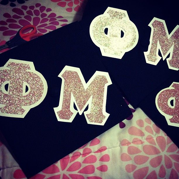 buy 4inch letters in glitter with a white border and put them on graduation cap