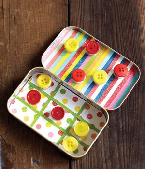 Make your own to go tic tac toe board by decorating an old Altoids box with scrap-booking paper! Then draw a board on one of the sides and use the other one to store some buttons.
