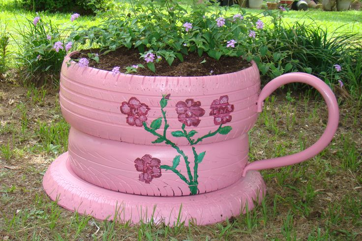 Cup and saucer with Lantana planted in top.