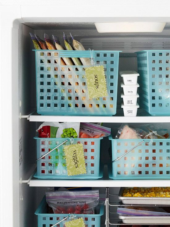 Utilitarian plastic baskets become a smart space-saver inside a crowded freezer. Use the baskets to organize packages by type (frozen pizzas in one, bags of vegetables in another, etc.) and nothing will get lost in the back of your freezer