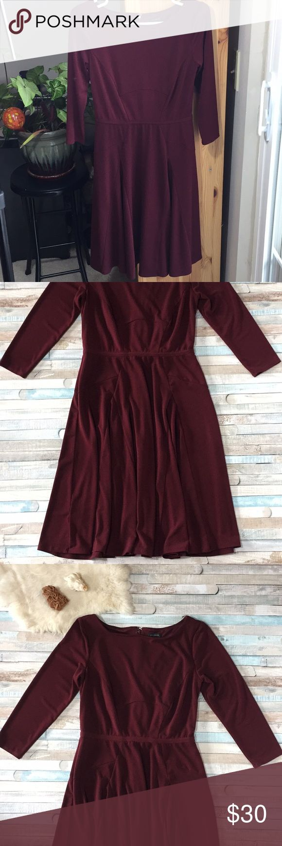 Ann Taylor Burgundy Fit and Flare Dress Size 2 Fabric is a polyester/spandex blend and is very stretchy. Size 2, bust measures 15.5in, Waist 13in, total length 37in. Gorgeous burgundy color, bracelet length sleeves, and a boat neck. Make an offer!! Ann Taylor Dresses Midi
