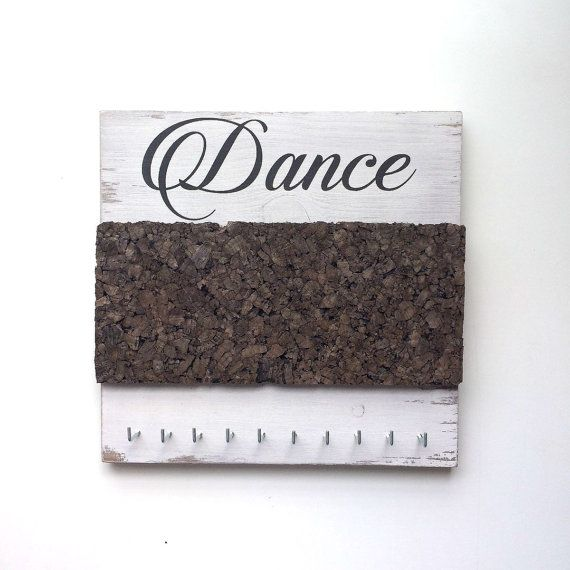 Hang your dance medals and ribbons on this awesome board. Plus have a place to put your hard earned pins!  You work hard for your medals, you should