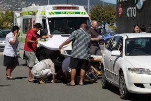 woman hit by reversing car at supermarket car park.