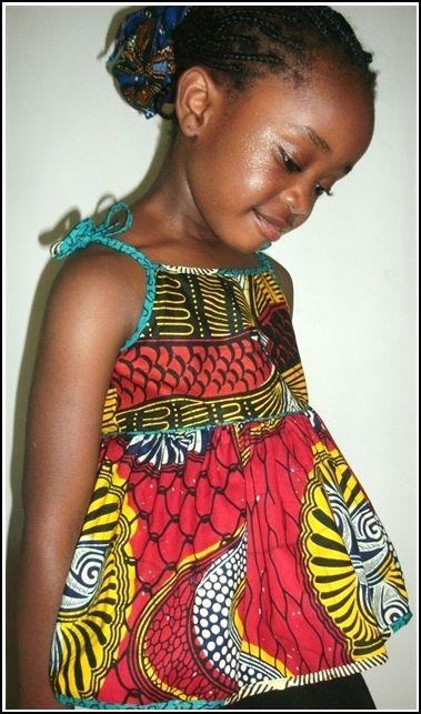 A Princess rocking an African print dress.  Cute!