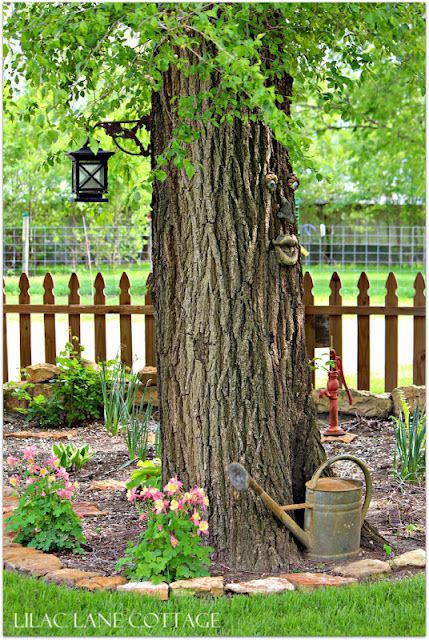Love the latern attached to the tree home outdoor for Garden scaping