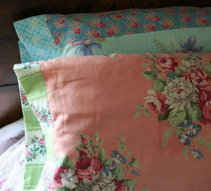 Vintage Pillowcases - vintage fabric from salvaged drapes and clothing was used to create pillowcases - via Rambling Rose