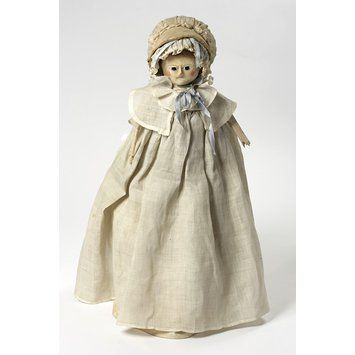 1770-1785  Wooden Doll, British. Gessoed head, neck, and chest, and a linen dress, and shows little attempt to create a lifelike doll. Different clothing was used to show gender, age, and occupation. Baluster-shaped body, flattened back,flat wooden arms, and wedge-shaped feet as favored by English dollmakers in the late 18th century. collections.vam.ac.uk