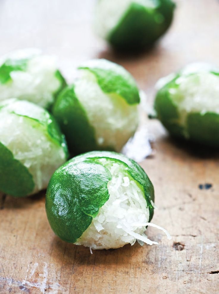 Limones Rellenos de Coco (Coconut Stuffed Limes) by Fany Gerson: A favorite of artist Frida Kahlo, these vibrant candied limes are completely edible and retain a slight bitterness that contrasts nicely with the sweet coconut filling. Eating them will make you feel like you are walking along the beach. Listen to the story on http://www.splendidtable.org/episode/december-11-2010  #Candy #Lime #Coconut #