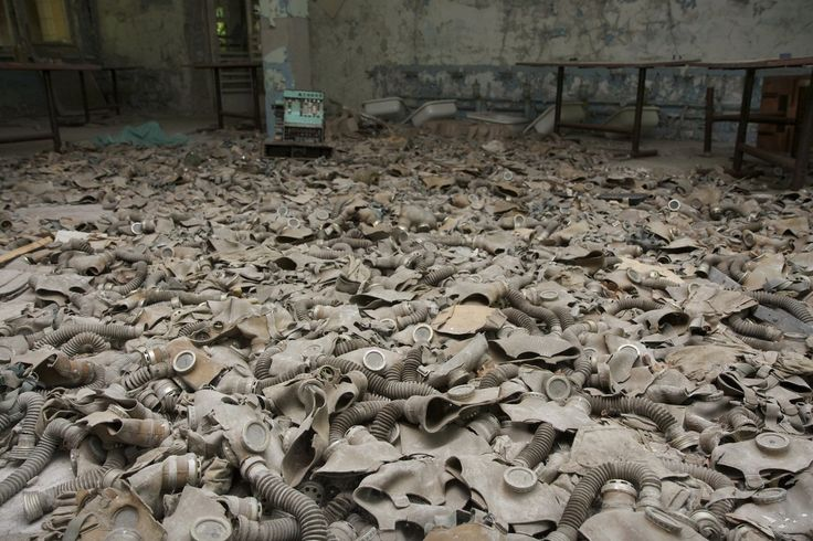 """This three-minute video titled """"Postcards from Pripyat, Chernobyl"""" takes viewers above and inside the eerie, abandoned city.   Gas masks strewn across the floor of the school cafeteria. A cash register and sinks for hand-washing can be seen in the background."""