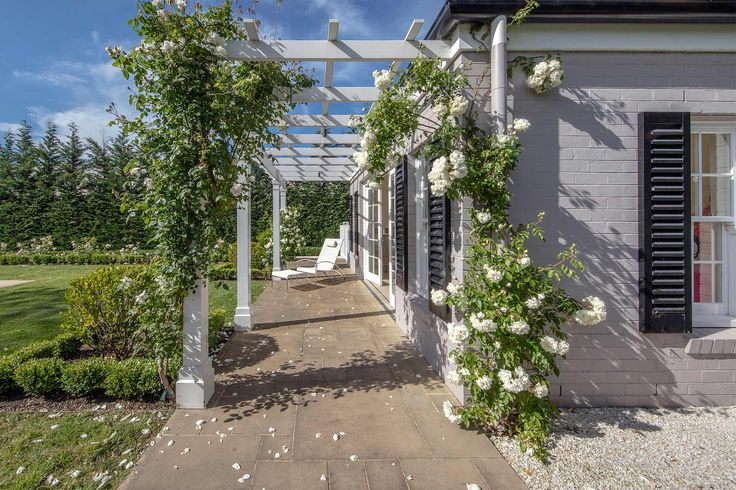 Timber Pergola in one of our Classical Gardens - Design by Eugene Gilligan Garden Design