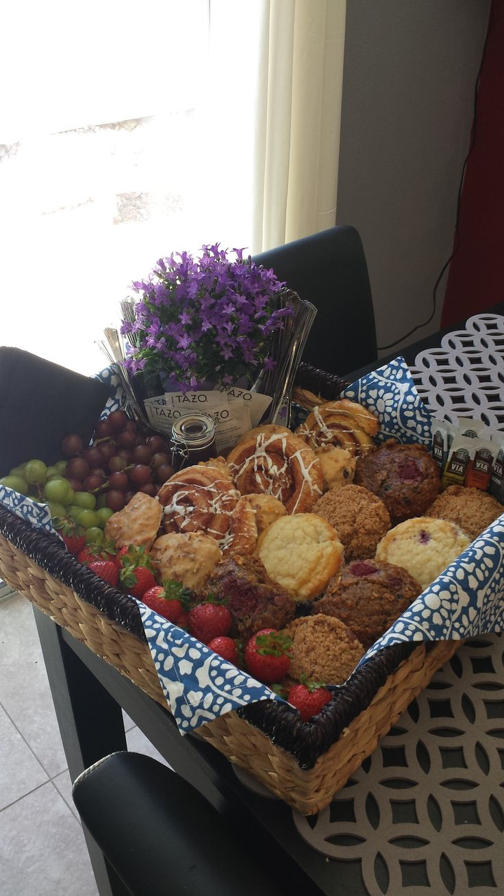 FDM sure knows how to assemble a gift basket!  This one is full of breakfast goodies like muffins, pastries, fruit, tea, and coffee.  Add a colorful floral arrangement for a pop of color!