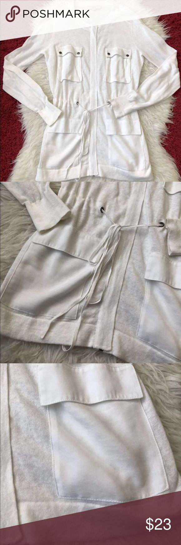 Ann Taylor Loft white zip up cardigan linen medium Ann Taylor Loft white zip up linen blend cardigan. Size medium. Lots of pockets, ties around the waist. Great condition! ann taylor loft Sweaters Cardigans