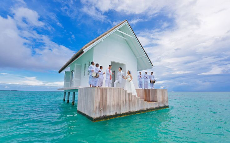 """The Four Seasons Maldives at Landaa Giraavaru is opening a floating overwater pavilion this month specifically made for couples looking to say """"I do"""" with a ridiculously stunning view."""