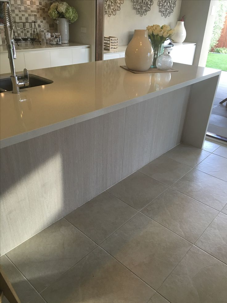 Timber look on outside of island bench - rest of kitchen white with stone benches