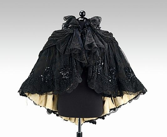 Evening cape  Date:     ca. 1895 Culture:     French Medium:     silk, fur Dimensions:     Length at CB: 34 in. (86.4 cm)