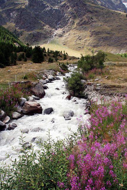 Saas Fee glacial stream by Jim Higham
