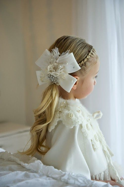 French braid in front makes this little girl's curly ponytail more elegant http://instagram.com/sparklysodastyle