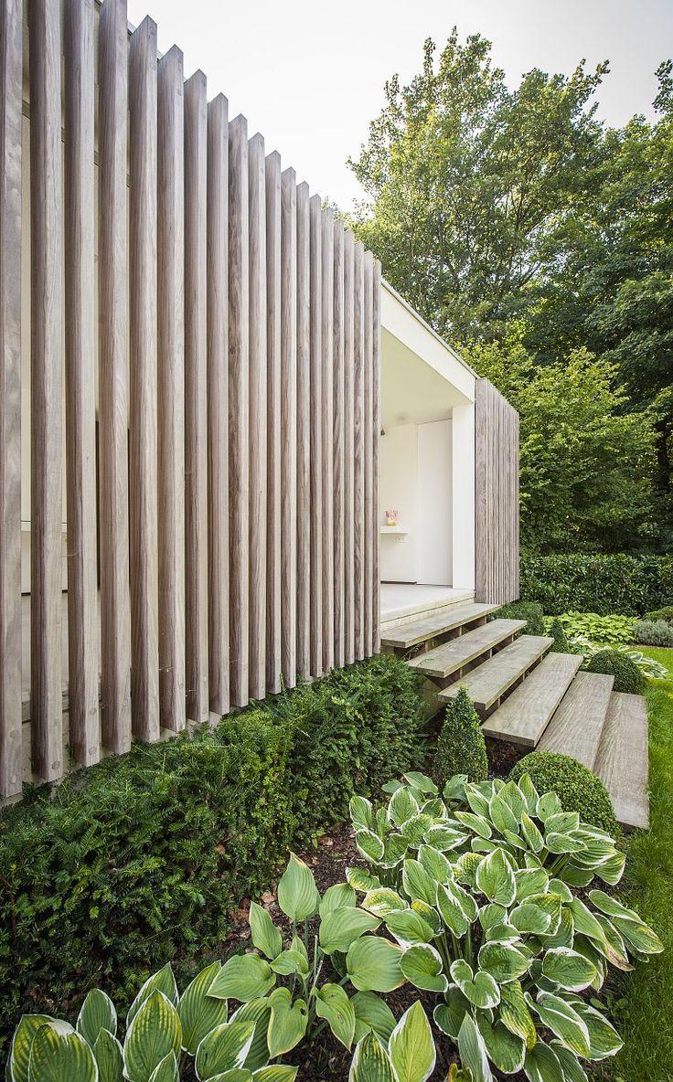 Modern poolhouse crépi met hout | Bogarden