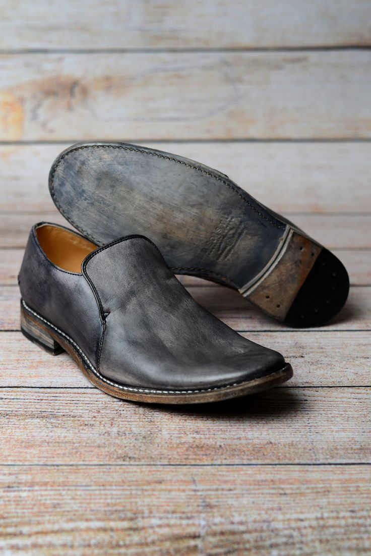 A classic loafer construction paired with unique, distressed finish.  Handmade Leather ShoesTan ...