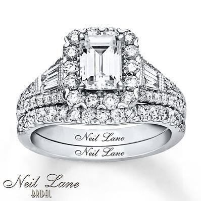 Round diamonds frame the distinct center emerald diamond to make a beautiful Neil Lane Bridal set.
