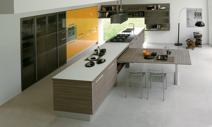 Beautiful, clean design with accents of lemon. This kitchen is the place for family and friends to congregate. #inspiration #kitchen #Eurocasa #yellow #white