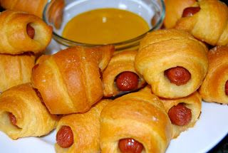 Pigs in a Blanket 1 pk Little Smokies (small cocktail wieners) 1/2 c shredded Colby Jack Cheese 2 package crescent rolls Unroll crescent rolls and cut into thirds, making 3 long triangle strips, sprinkle with shredded cheese. Add weiners and start rolling - start at fat end and roll up crescent style. Place on cookie sheet and bake at 350º for 10 minutes or until golden brown.  Dip in honey mustard.