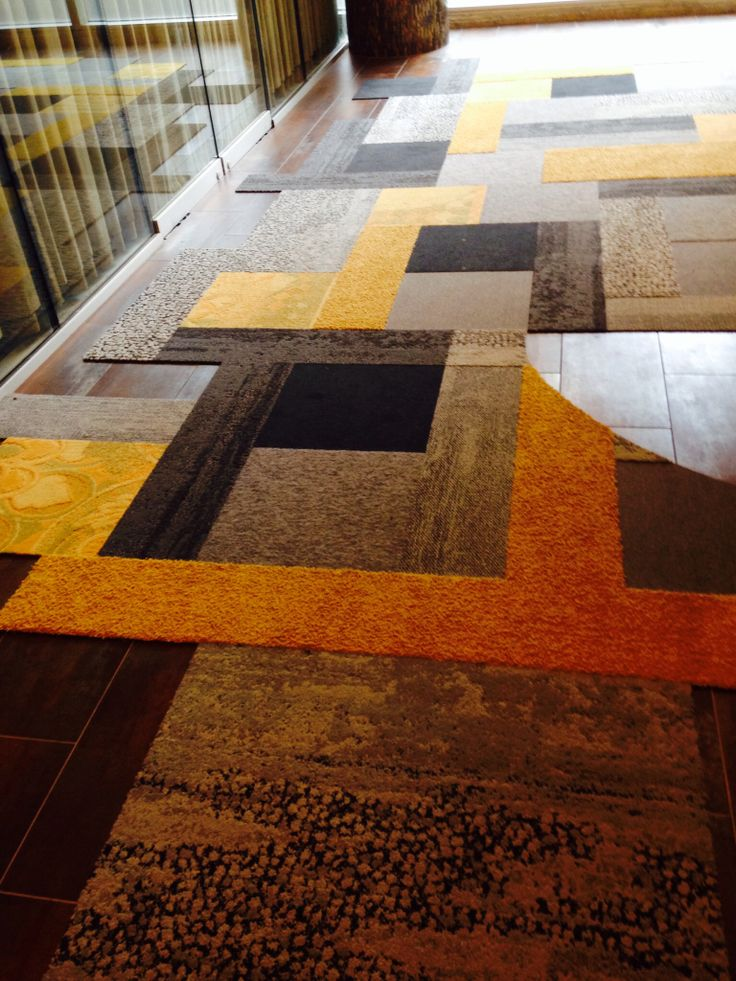Interface Carpet Tile Pattern At The Entry Of Their Showroom.