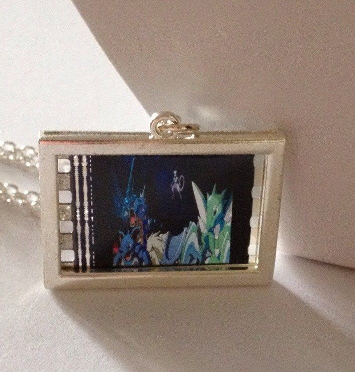 A personal favourite from my Etsy shop https://www.etsy.com/uk/listing/279817612/pokemon-necklace-pokemon-film-cell