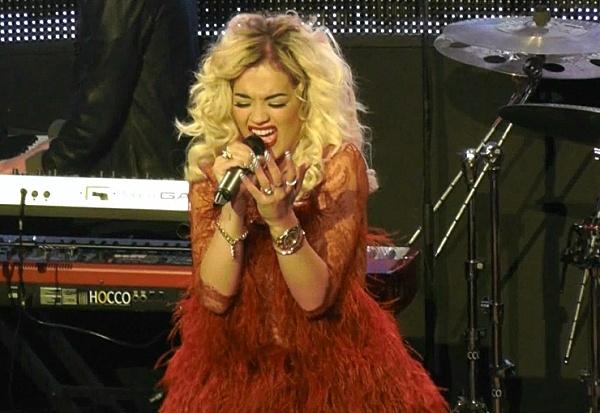"Rita Ora in 'Corrie"" Red Ostrich feather dress Natalia Kaut"