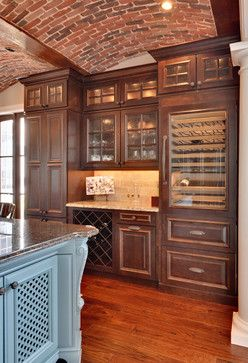 Butlers Pantry Design in kitchen with eye level wine fridge.  brick ceiling